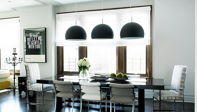 jarlath-mellet-cococozy-dining-room-table-city-apartment-black-pendant-lights-typography-art